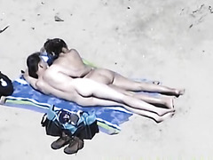 Sexually Lascivious wife with big bumpers on beach gives cook jerking to husband out of knowing they are filmed