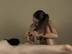 She tickles his cock with a boa then hairjob cumshot in her hair