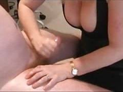 mature man milks prick on her tits